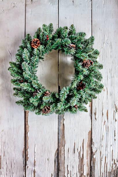 Christmas wreath on an antique white wooden background or on the door picture id880352880?b=1&k=6&m=880352880&s=612x612&w=0&h= yx1o4jyn qxbmvj7a5vrc390pfjybm9 zgz0drsa1m=