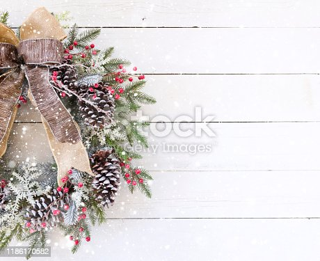 Christmas pine wreath on an old white wood background