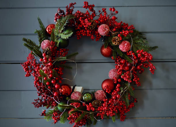 Christmas wreath on background of a gray wooden wall stock photo