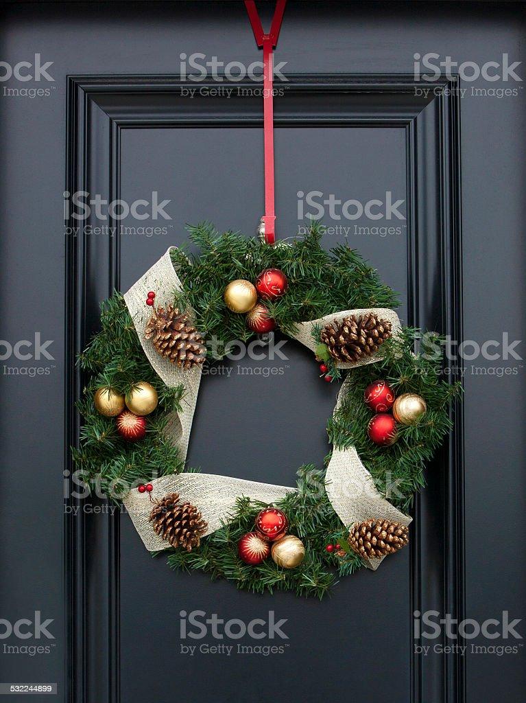 Christmas wreath on black door stock photo