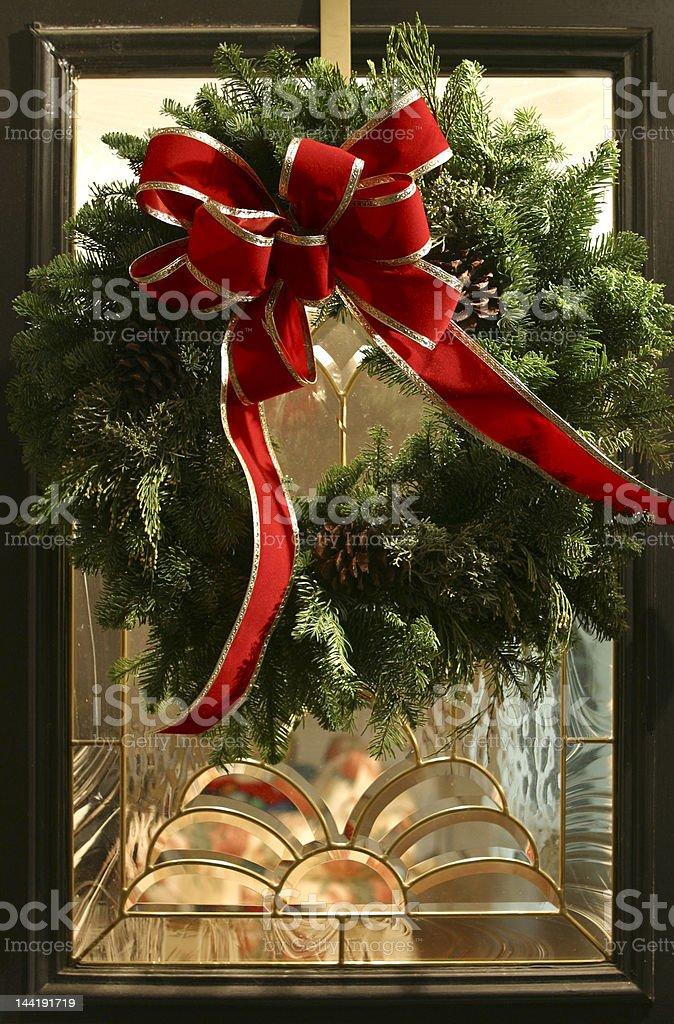 Christmas wreath on glass door royalty-free stock photo