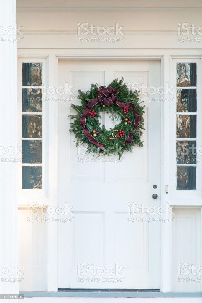 Christmas Wreath on Old Door stock photo