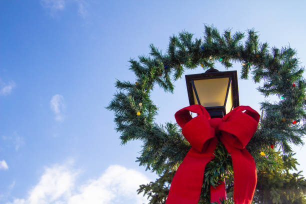 Christmas Wreath On Old Fashioned Street Lamp stock photo