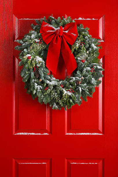 Christmas Wreath on Red Door stock photo