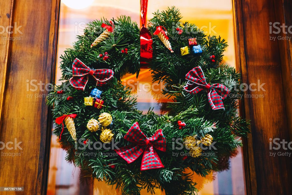 Christmas wreath on the store glass wooden door. stock photo