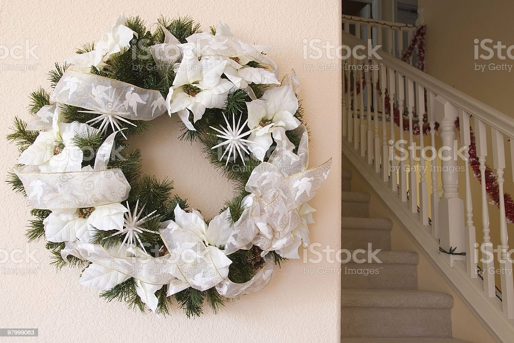 Christmas wreath on the wall royalty-free stock photo