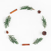istock Christmas wreath on white background. Flat lay, top view, square 859821320