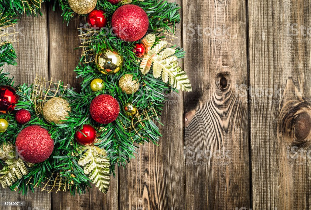 Christmas wreath on wooden door, decoration with ornaments on fir...