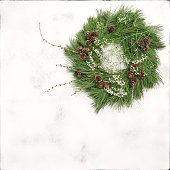 istock Christmas wreath pine cones white flowers stone background 628464234