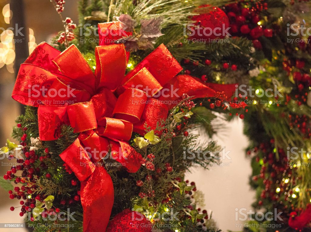 Christmas Wreath With Beautiful Red Ribbon And Berries stock photo