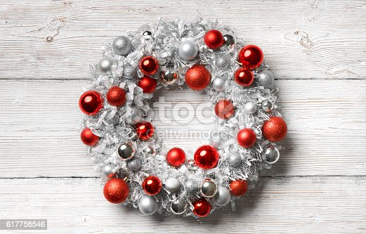 istock Christmas Wreath Wood Background, Hanging Holiday Decoration Balls, Wooden Wall 617758546