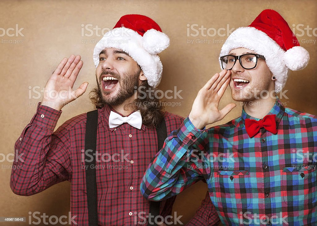 Christmas, x-mas, people, advertisement, sale concept - happy tw royalty-free stock photo