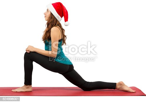 Yoga woman with Santa hat doing low lunge pose