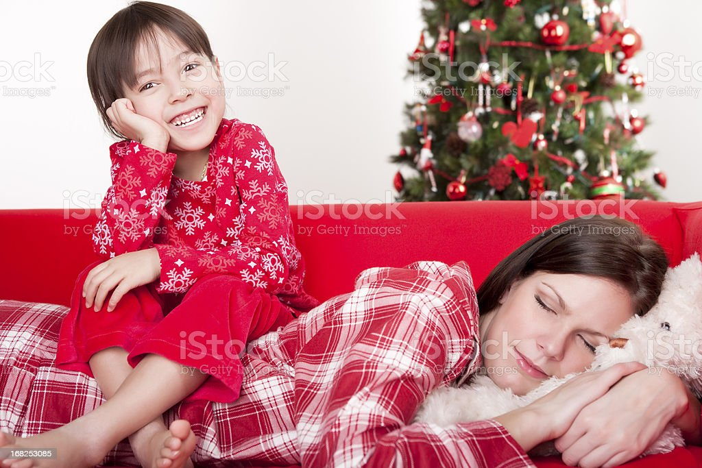 Christmas-Daughter sitting on mother's back royalty-free stock photo