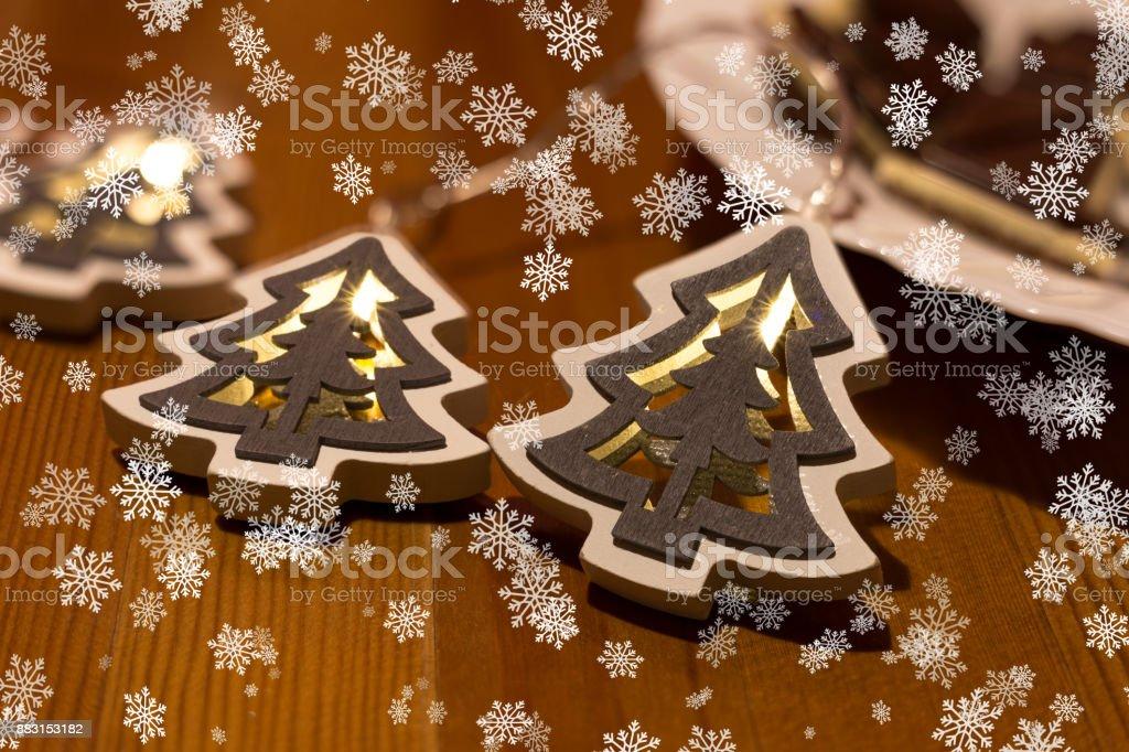 Christmass tree lights on a table and big snowflakes Christmass tree lights on a table and big snowflakes Art Stock Photo