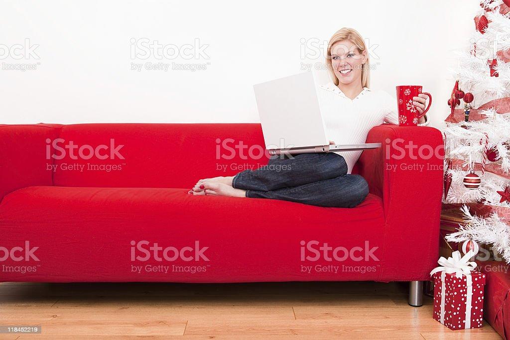 Christmas-Woman using laptop royalty-free stock photo