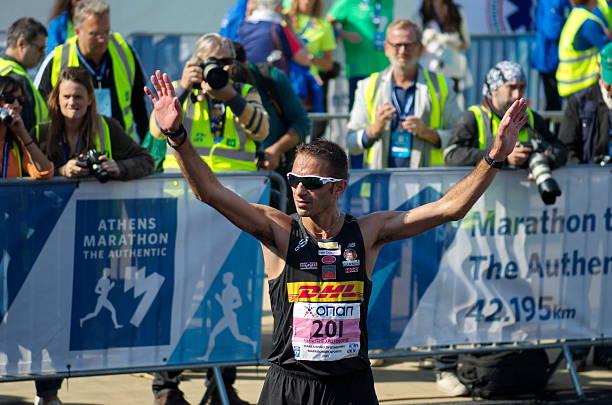Christoforos Merousis clebrates after winning the 33th Athens Classic Marathon stock photo