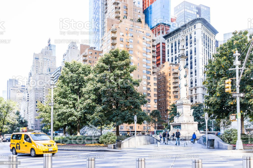 Christopher Columbus Circle in Midtown Manhattan with statue, skyscrapers, taxi cab traffic, fountain on sunny day stock photo