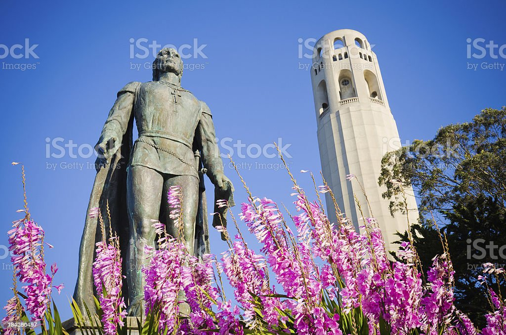 Christopher Columbus statue and Coit Tower in San Francisco, CA stock photo