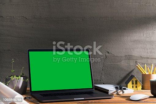 istock Chroma key green screen laptop on table. 1093846768