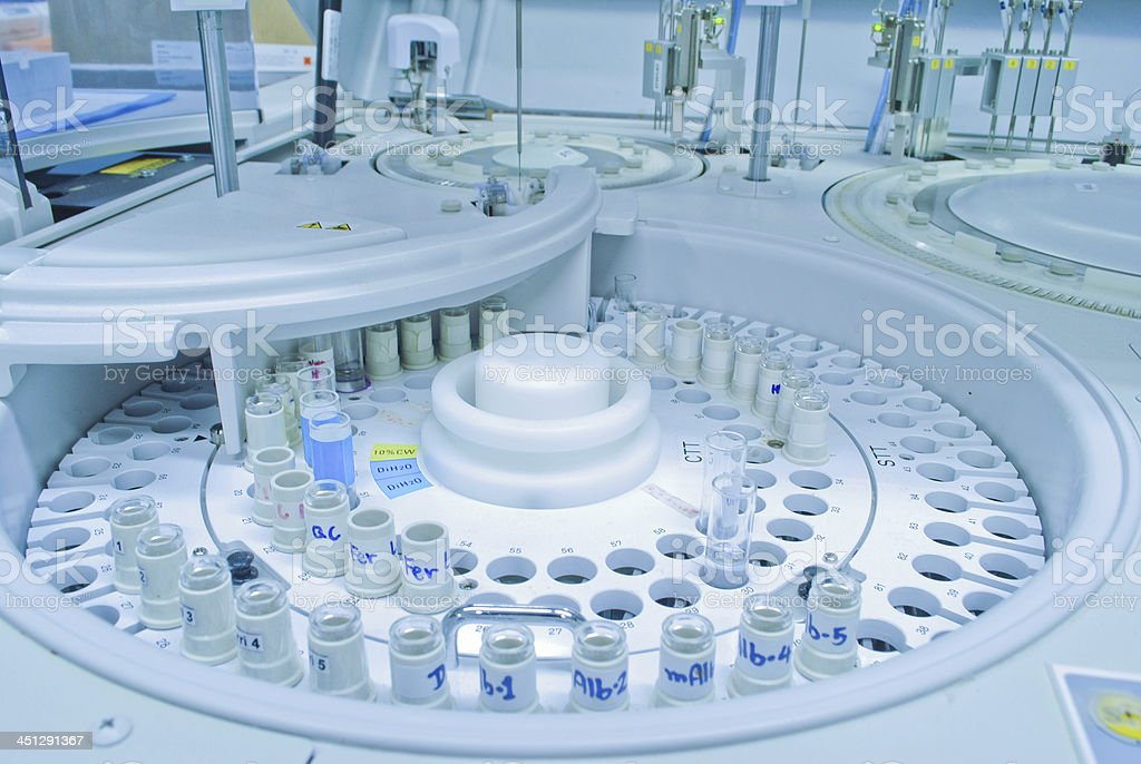chromatograph with glass sample bottles stock photo