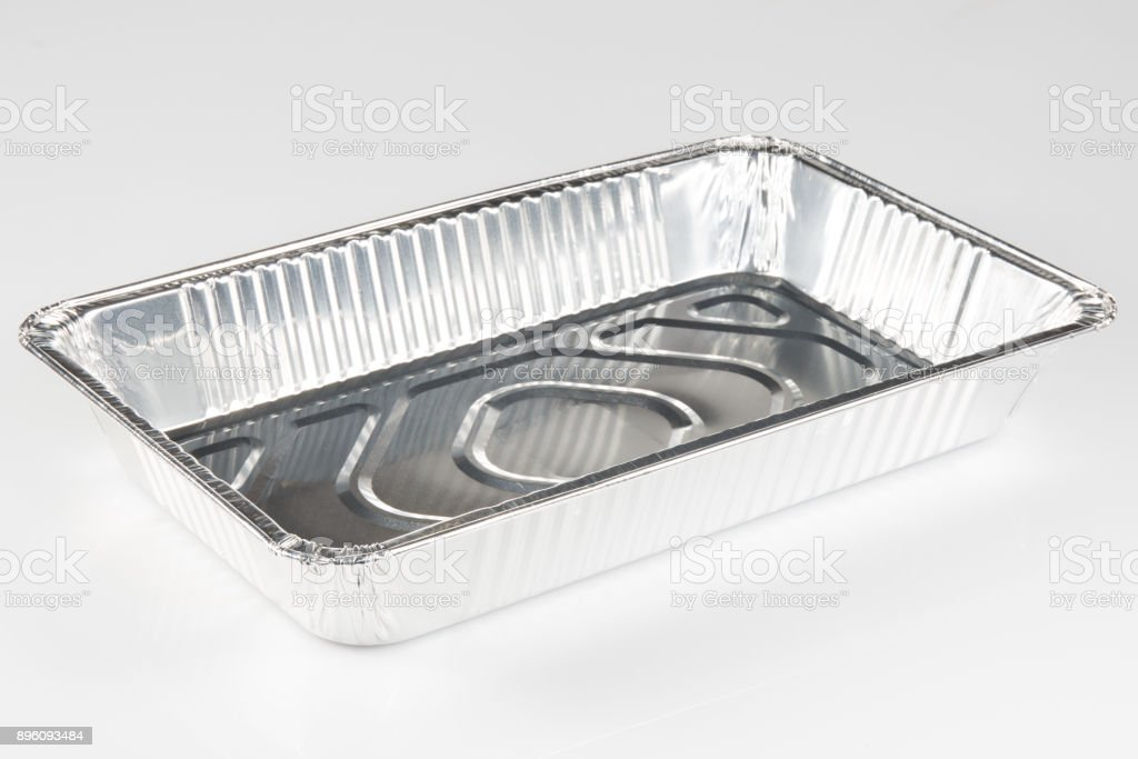 A chrome aluminum tray to receive food on a white background stock photo