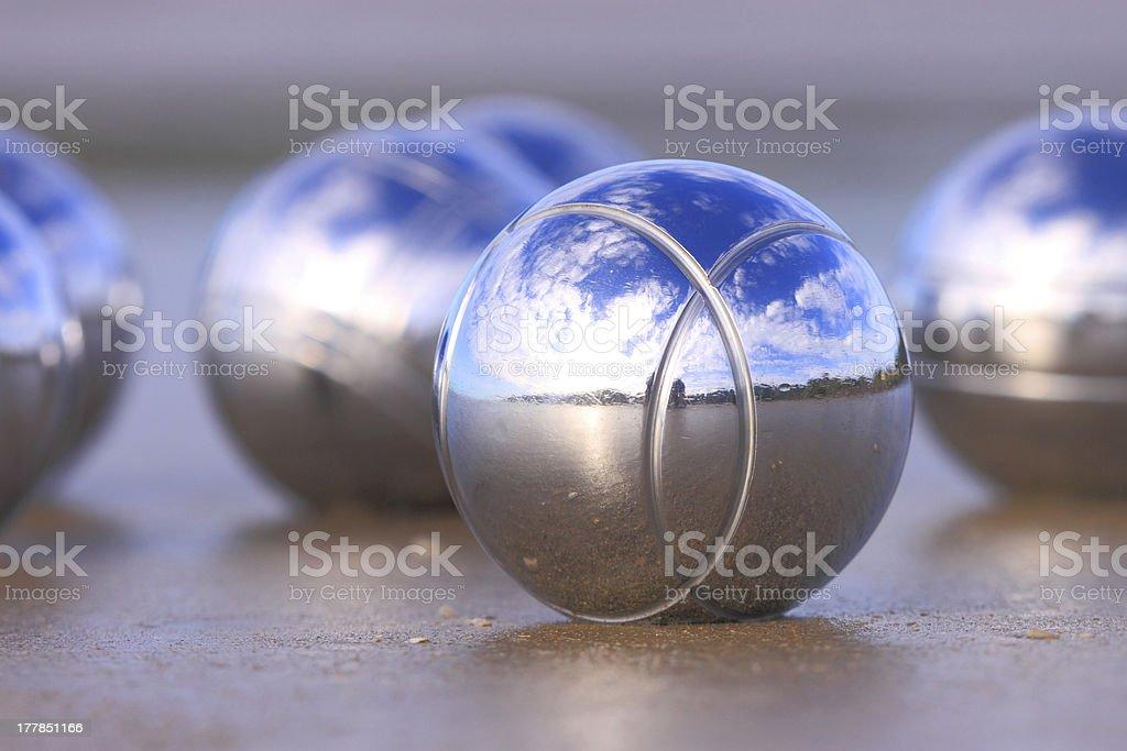 Chrome boules on a beach royalty-free stock photo