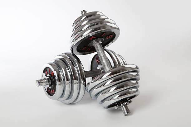Chrome dumbbells on the white background. stock photo