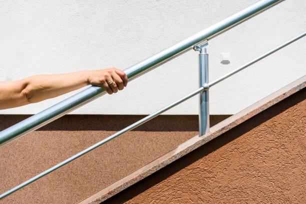 chrome fence on staircase. stock photo