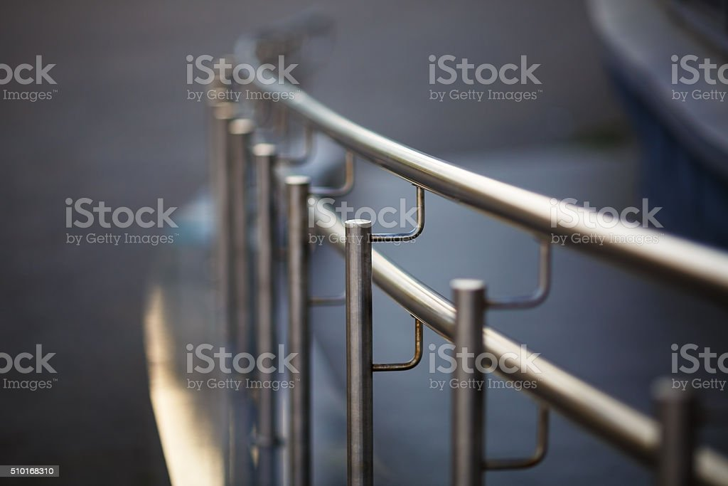 Chrome fence with handrail stock photo