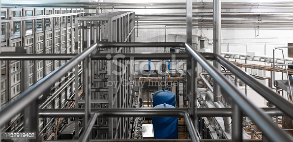 1132919442 istock photo Chrome pipes and blue element. Industrial background 1132919402