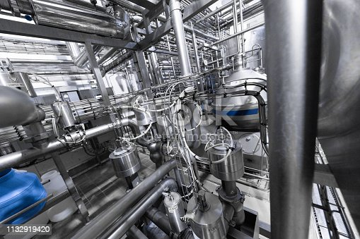 1132919442 istock photo Chrome pipes and blue element. Industrial background 1132919420