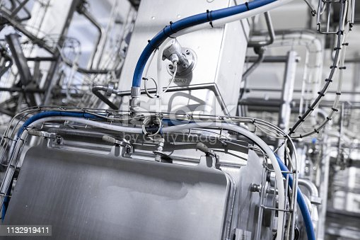 1132919442 istock photo Chrome pipes and blue hose. Industrial background 1132919411