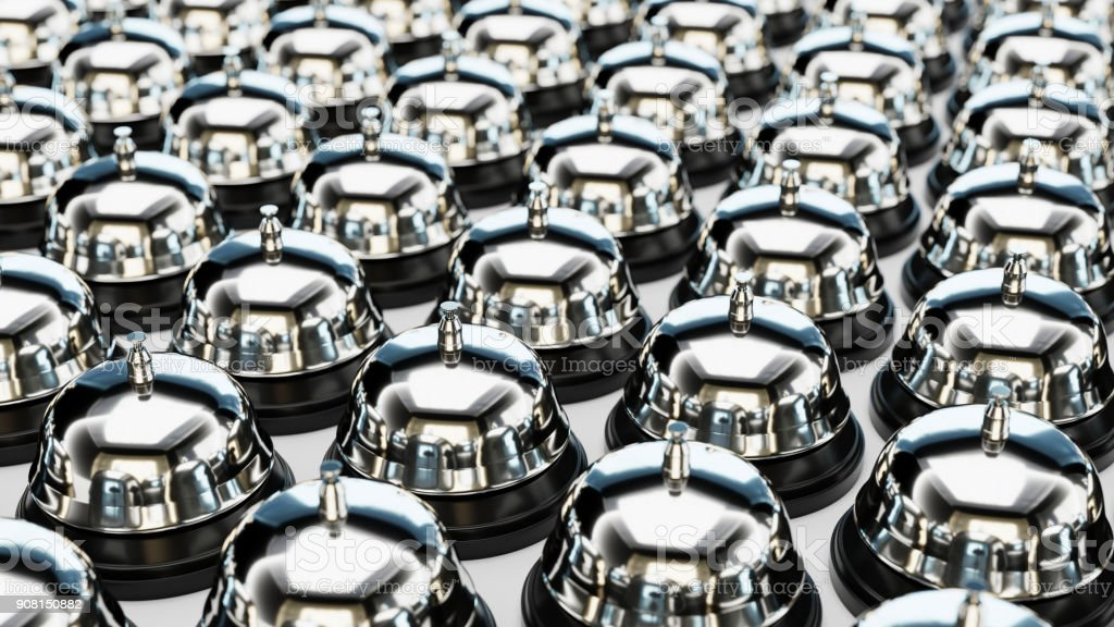 Chrome Reception Bells in an Even Grid on a Simple Concrete Surface stock photo