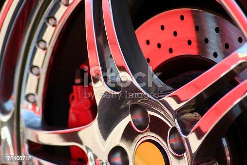 A close up shot of a chrome exotic car rim.