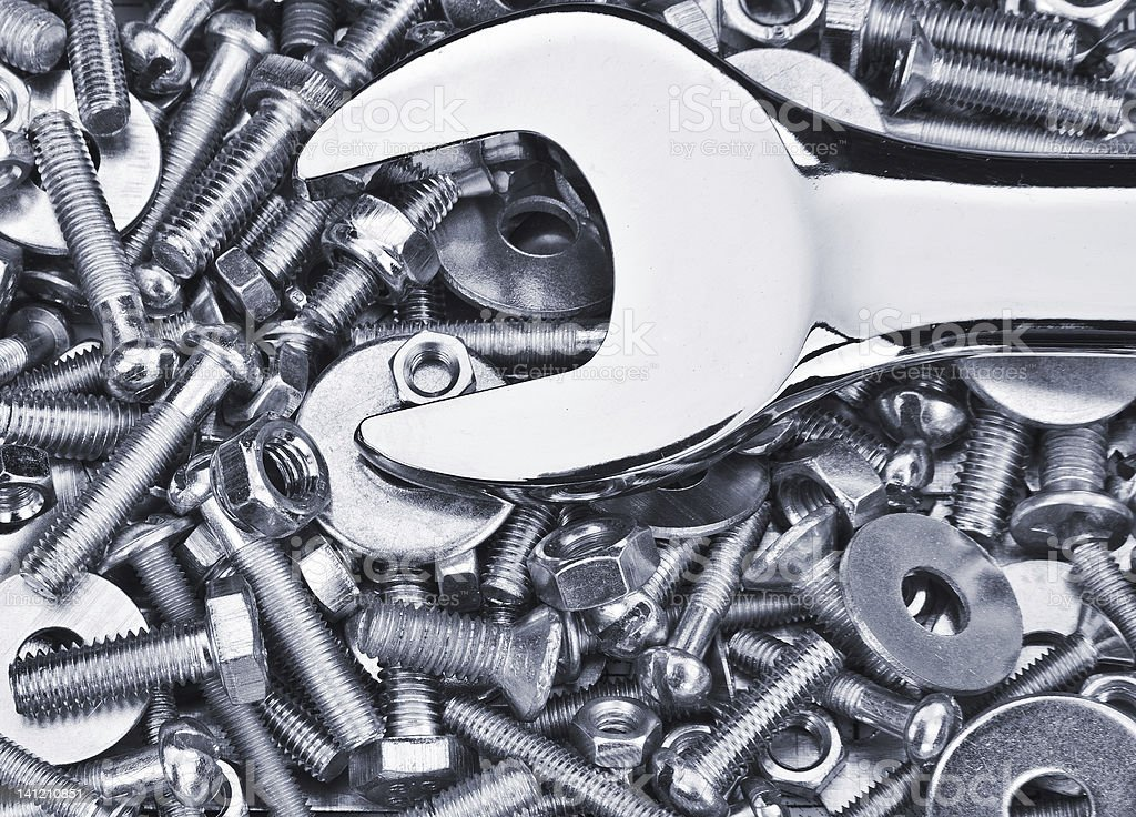 Chrome spanner, nuts and bolts useful as a background royalty-free stock photo