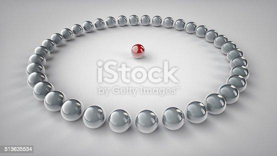 1007383644 istock photo Chrome spheres aligned around a red metallic sphere. 513635534