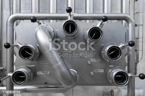1132919452 istock photo Chrome system with levers in industrial plant 1132919724