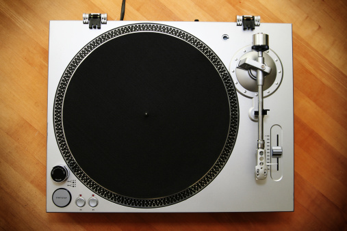 Chrome Turntable / Record Player on Wood Background