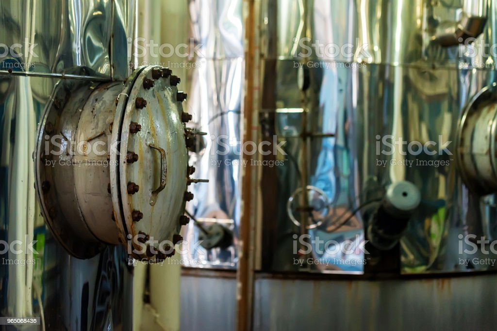 Chrome wine tanks at modern winery royalty-free stock photo