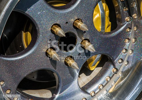 Chromed car wheels with disc brakes, close-up