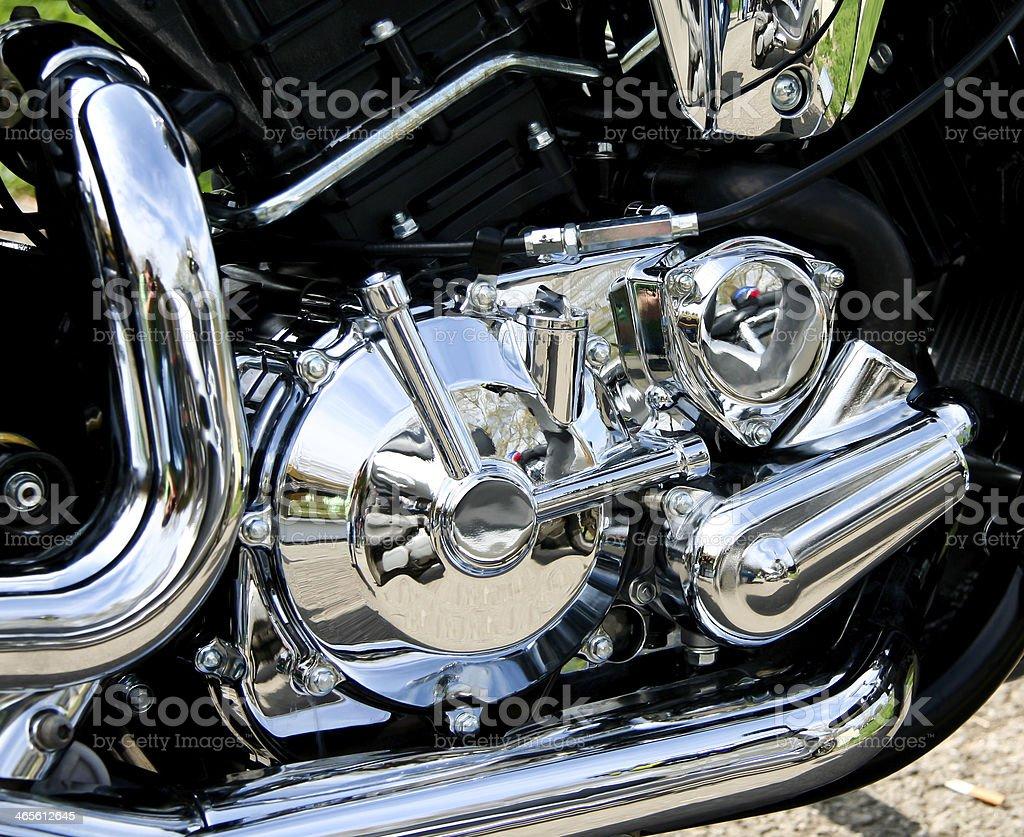 Chromed engine Shiny chrome on a motocycle. At The Edge Of Stock Photo
