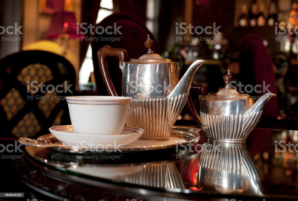 Chromed silver tea set on table stock photo