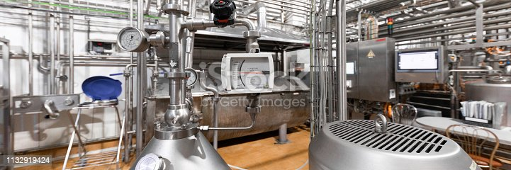 1132919452istockphoto Chrome-plated pipes, pressure sensors, wires and devices. Industrial background 1132919424