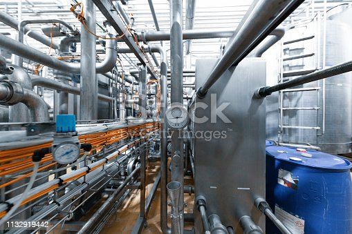 Production chrome background with pipes and wires. Metal pipes close-up. Industrial plant inside view. Rectangular metal pipes . Steel materials, construction supplies