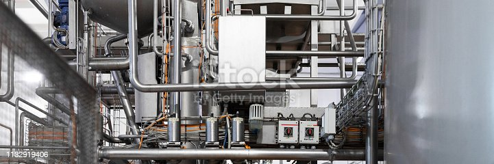 1132919442 istock photo Chrome-plated pipes, wires and devices. Industrial background 1132919406