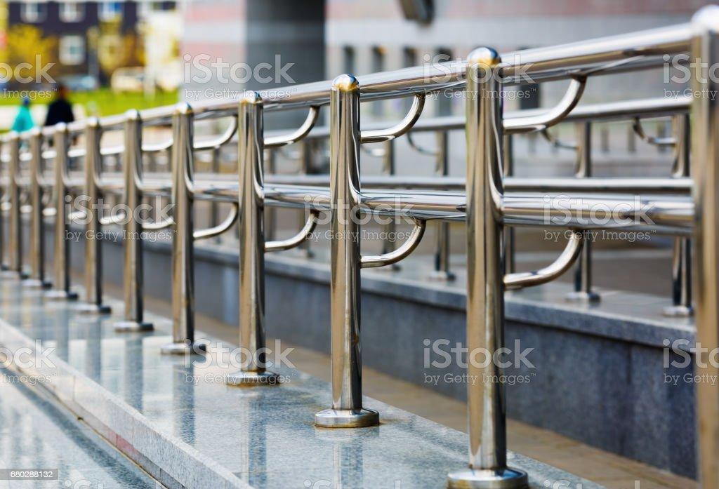 Chromium metal fence stock photo