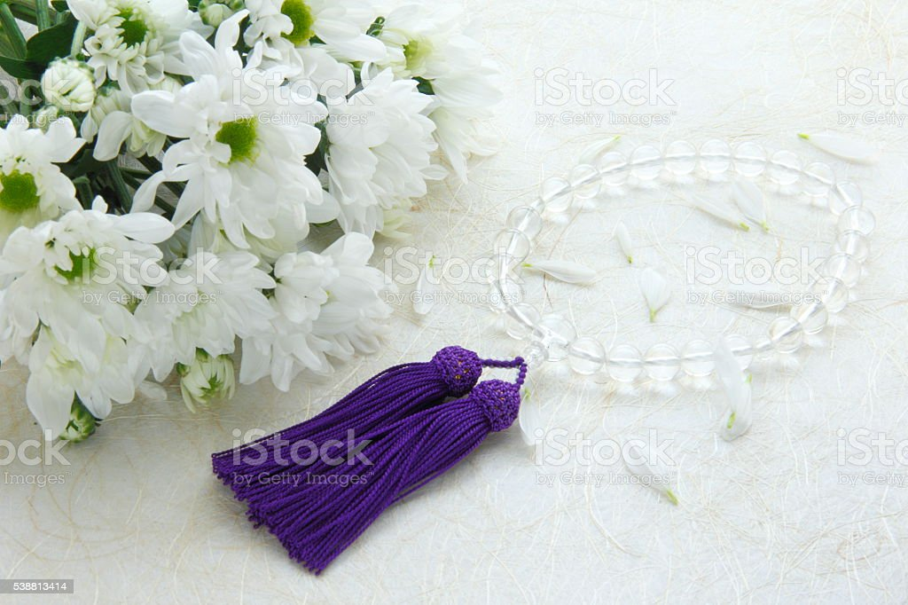 Chrysanthemum bouquet and rosary stock photo