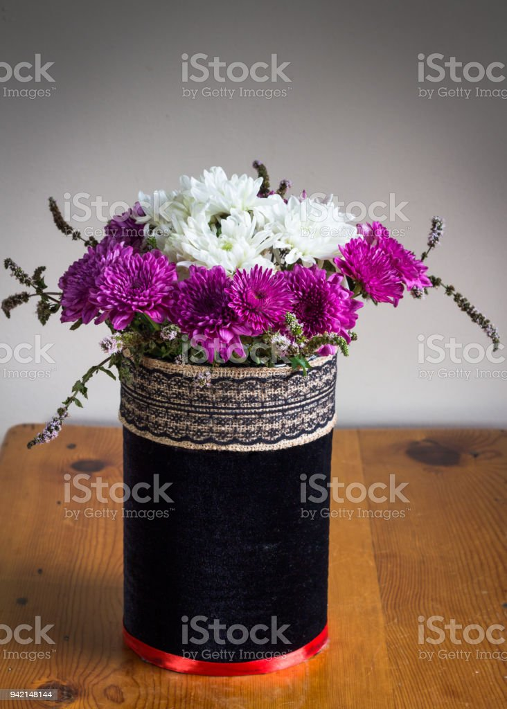 Chrysanthenums in a rustic black velvet covered vase with chrysanthenums in a rustic black velvet covered vase with embroidered ribbon band purple and white mightylinksfo