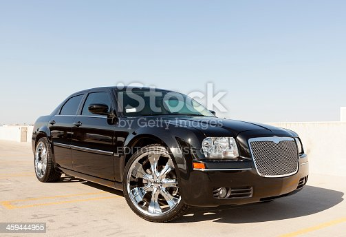 Scottsdale, United States - August 30, 2011:  A phot of a parked black Chrysler 300. The 300 from Chrysler recently got a redesign in 2011 and is a popular sedan in the US.